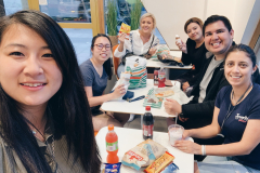 Becca Gerlich, Mary Hayward, Drue Grimes, Sandra Ramirez, Julian Martinez, and Veronica Potter enjoying Danish food and candy